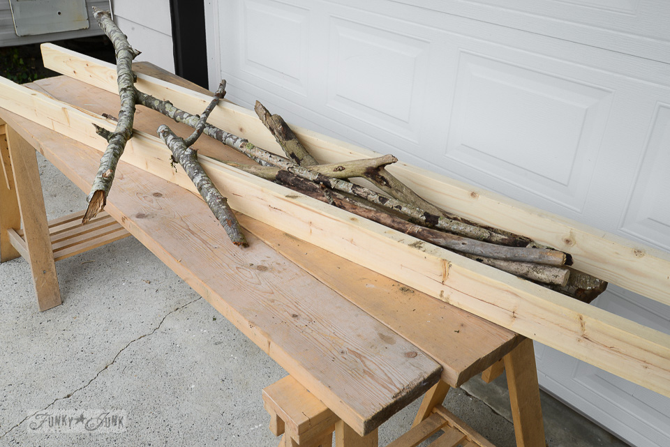 Supplies of 2x4s and branches to make a nature inspired branch ladder plant stand / funkyjunkinteriors.net