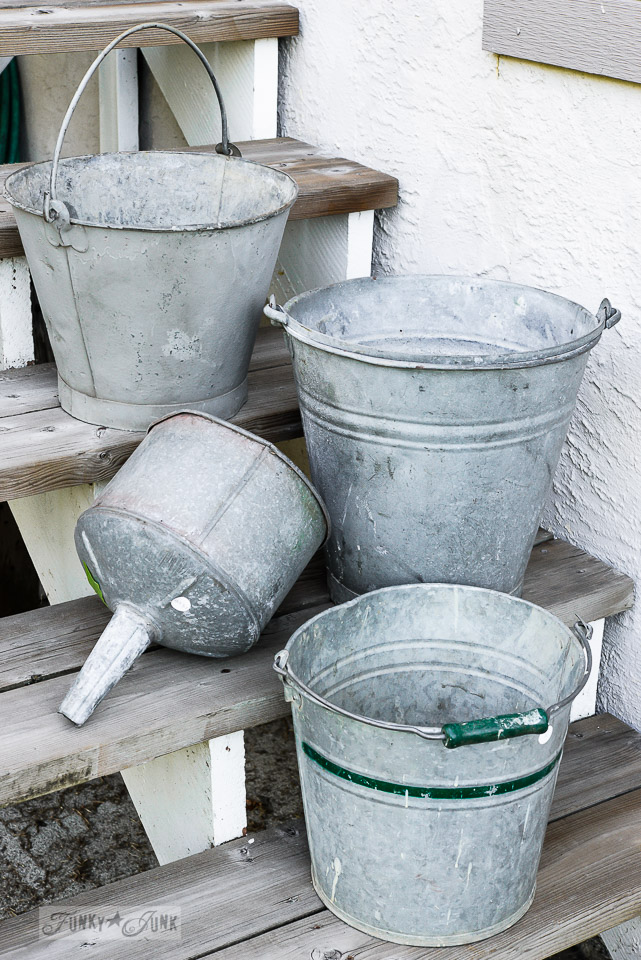 How to plant galvanized buckets for flower planters on a ladder! Click for full tutorial and see the beautiful outcome! #planters #flowers #ladder