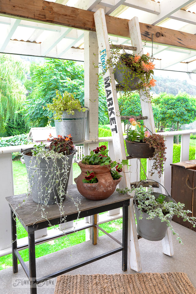 Flower Market branch ladder plant stand on a patio | funkyjunkinteriors.net