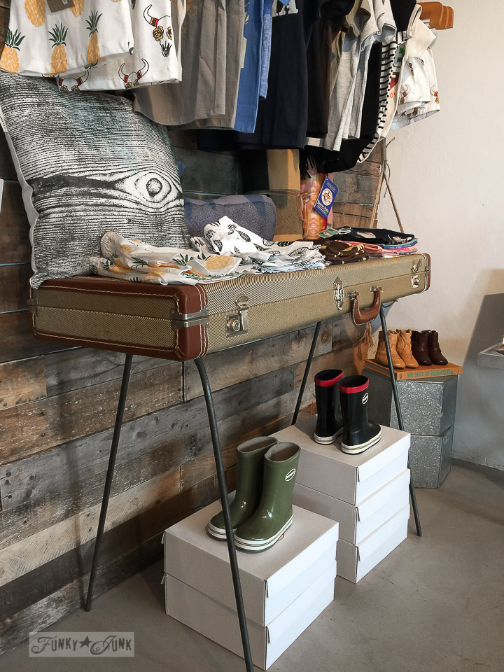 Suitcase table with hairpin legs inside Homme by Nature in Makawao, Maui / funkyjunkinteriors.net