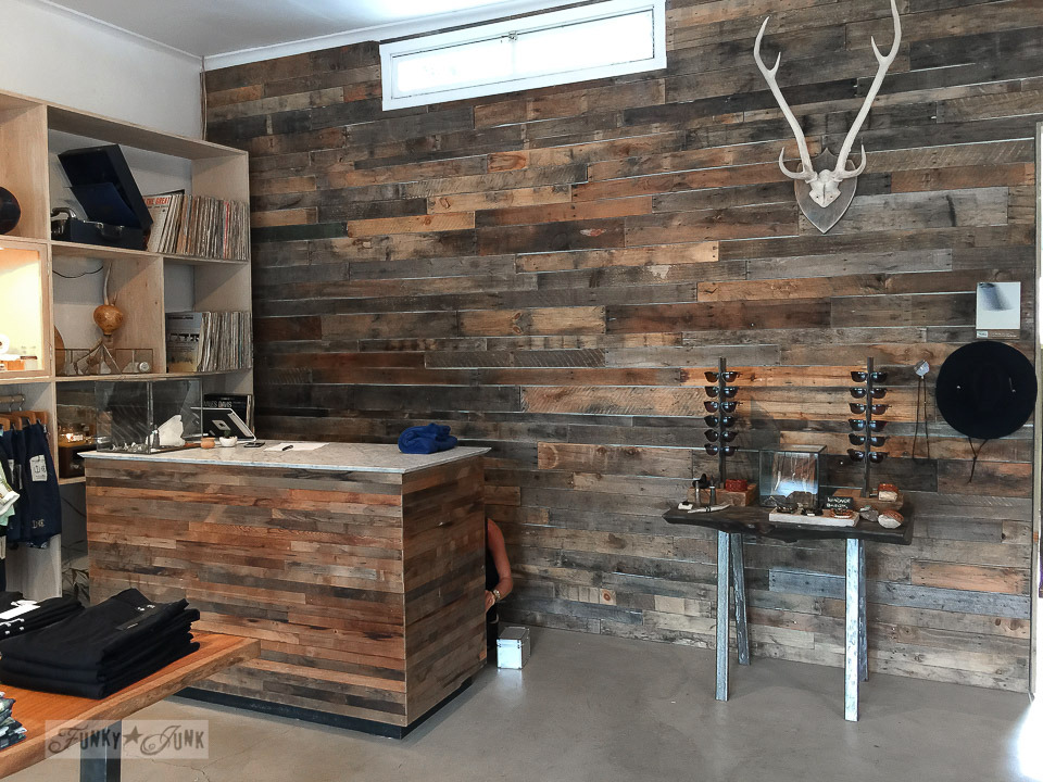 Pallet wood wall and front counter inside Homme by Nature in Makawao, Maui / funkyjunkinteriors.net