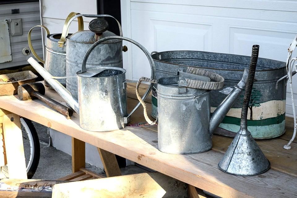Galvanized watering cans / funkyjunkinteriors.net