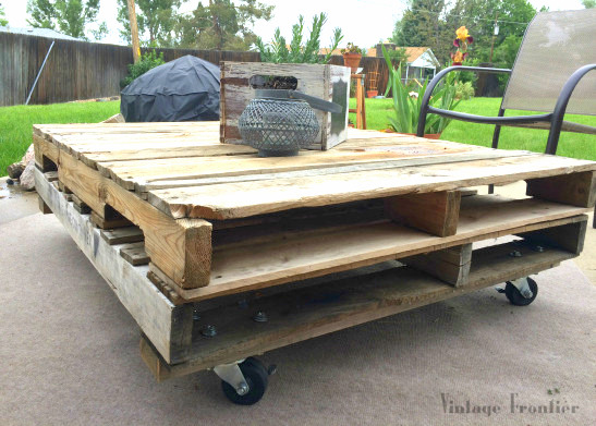 Stacked pallet wood coffee table by Vintage Frontier, featured on Funky Junk Interiors