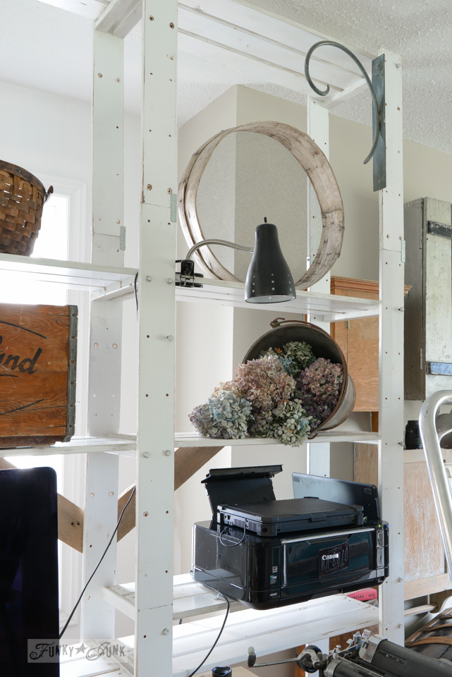 stocking shelves with dried hydrangeas and antiques / funkyjunkinteriors.net