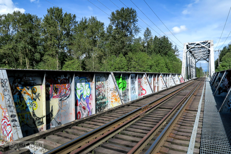 graffiti on a train track barrier / funkyjunkinteriors.net
