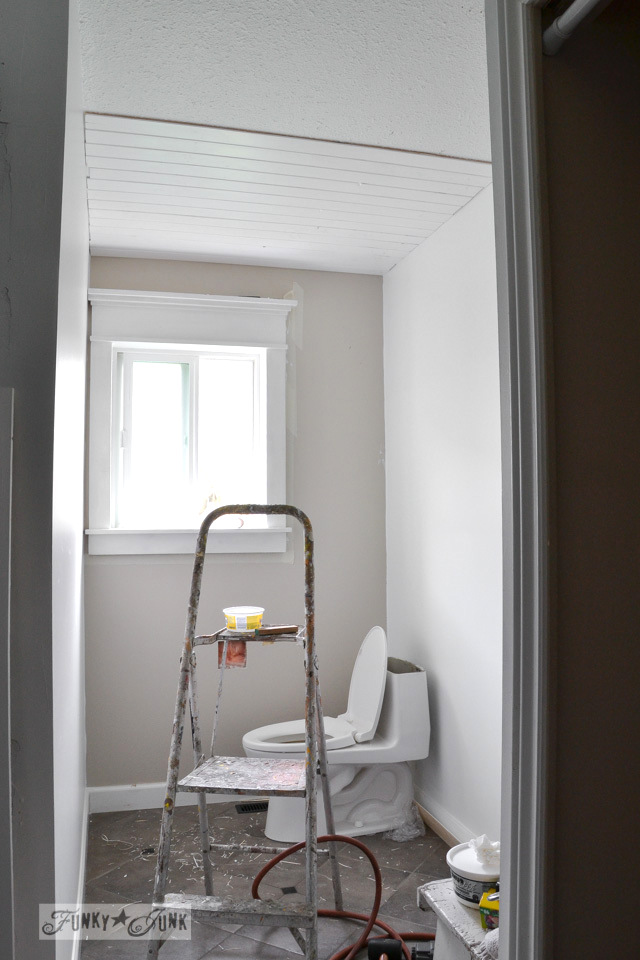 covering popcorn ceiling with planks in bathroom