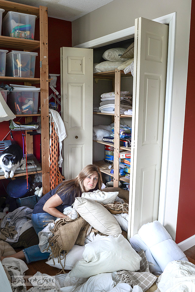 messy linen closet before / funkyjunkinteriors.net