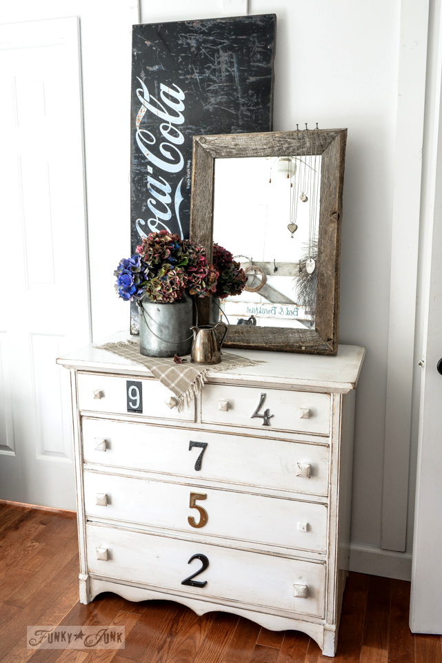 Fall hydrangeas in a milk bucket, with a house numbered white dresser and black coca cola sign / funkyjunkinteriors.net