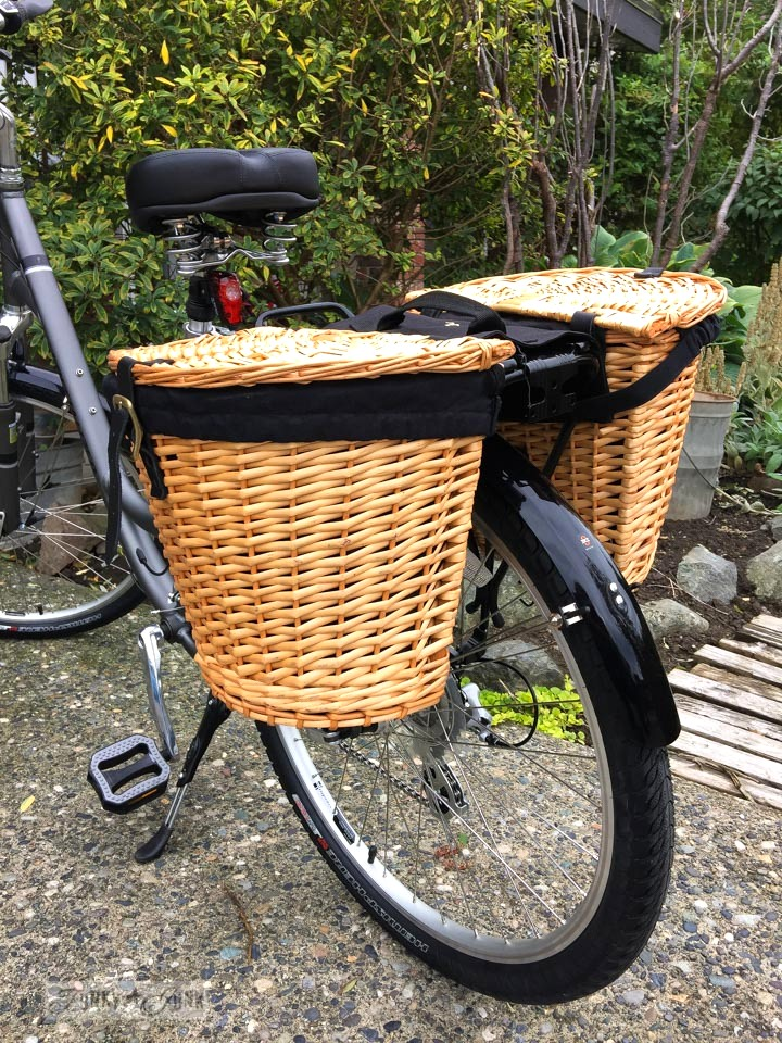 Pannier bike baskets - part of Learn how to buy the best bike for you with 10 must-get accessories! You will fit your custom-fit bike so well, you won't want to get off of it! Learn all the tips in this post.