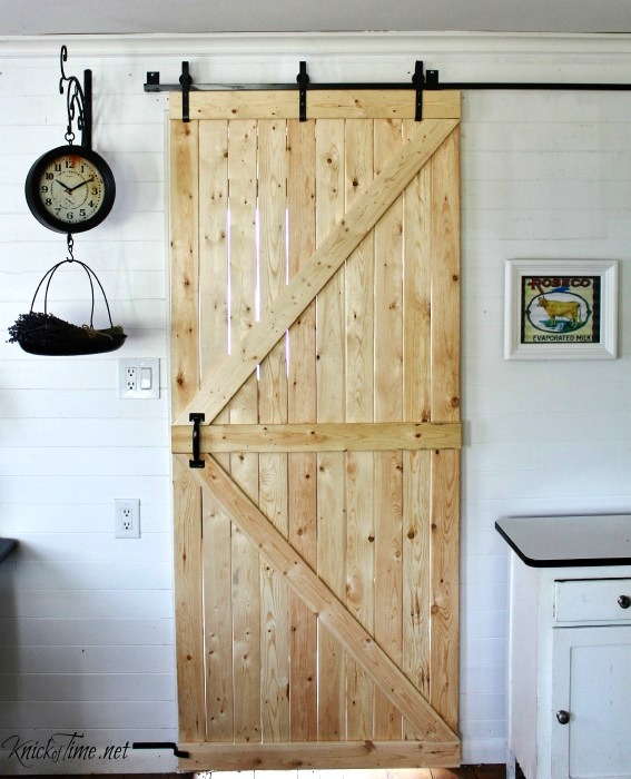 DIY sliding barn door, by Knick of Time, featured on Funky Junk Interiors