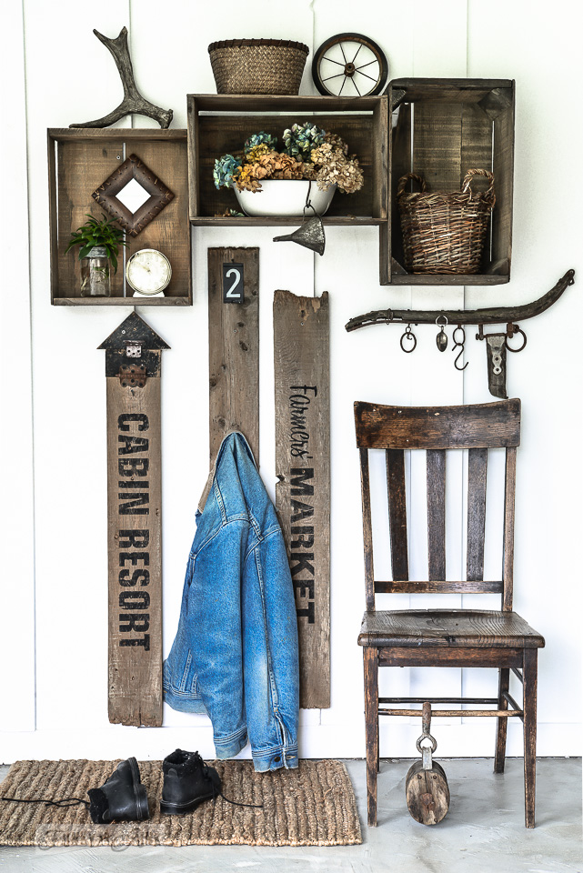 How to create a compact coat hooks area with old signs and crates. Click to full tutorial.