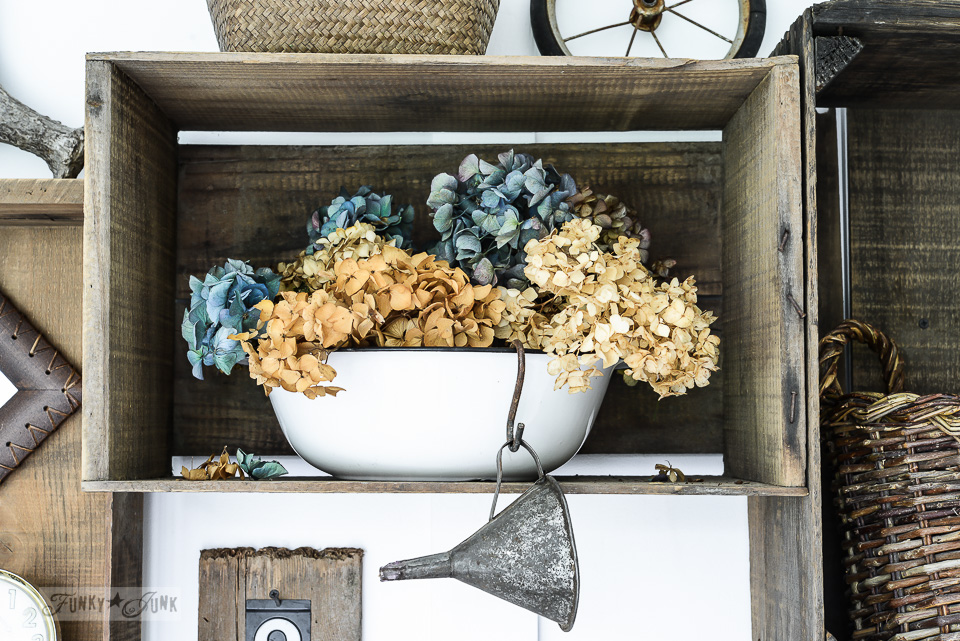 Old crates cubby in an entry with dried hydrangeas in an enamel bowl / funkyjunkinteriors.net
