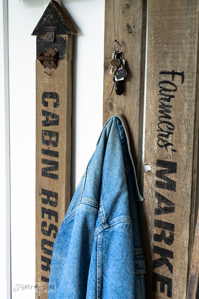 Old signs for a coat hanger in an entryway made with Funky Junk's Old Sign Stencils / funkyjunkinteriors.net