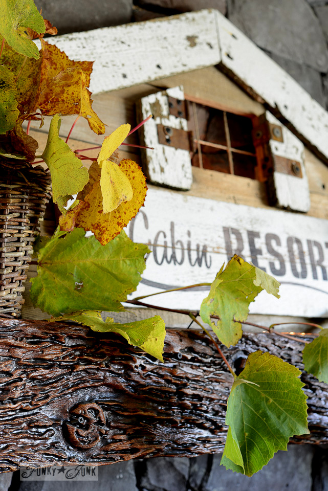 Fall grapevine leaves with a reclaimed wood fall mantel Cabin Resort sign / funkyjunkinteriors.net