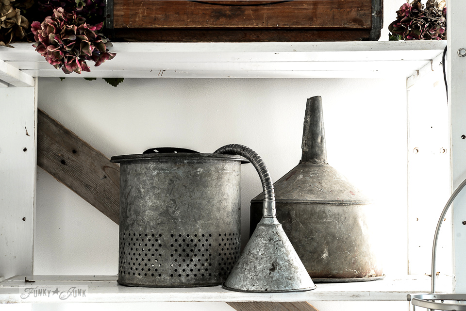 Galvanized funnels and bait pail for an office vignette / funkyjunkinteriors.net