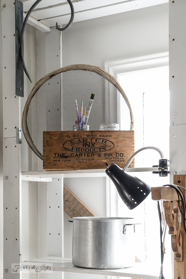 Old crate storage for paint brushes in an office / funkyjunkinteriors.net