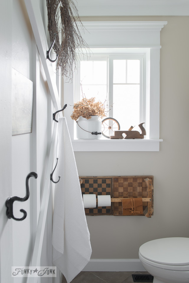 salvaged farmhouse bathroom makeover, with vintage moulding and a planked ceiling / funkyjunkinteriors.net