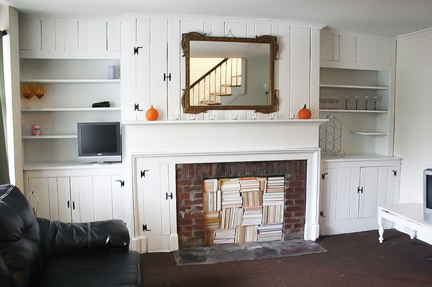 Planked and booked fireplace wall, by The Honeycomb Home, featured on Funky Junk Interiors