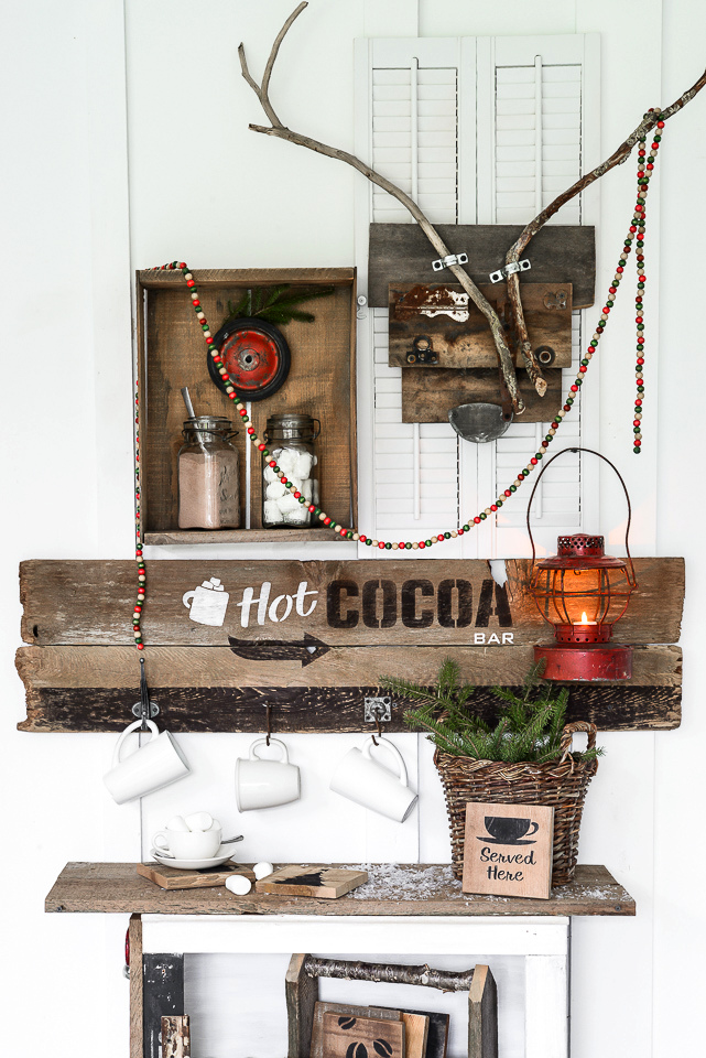 Rustic Hot Cocoa Bar station with old sign and crate shelf, and reclaimed wood deer, created with Funky Junk's Old Sign Stencils / funkyjunkinteriors.net/