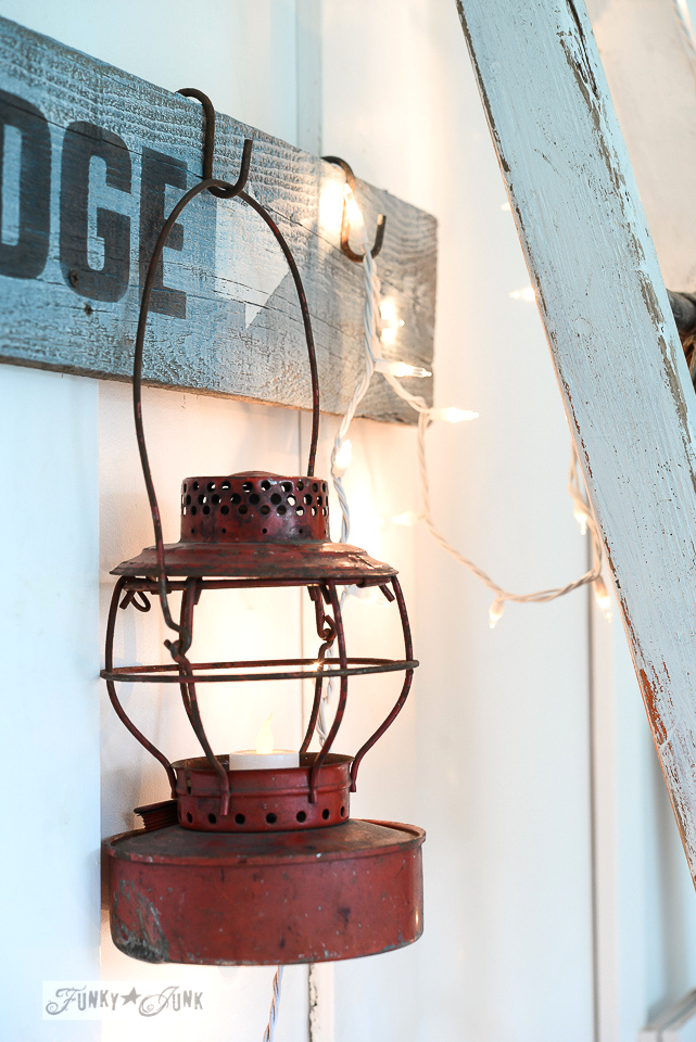 red lantern illuminated with a battery operated votive candle for Christmas and winter decor