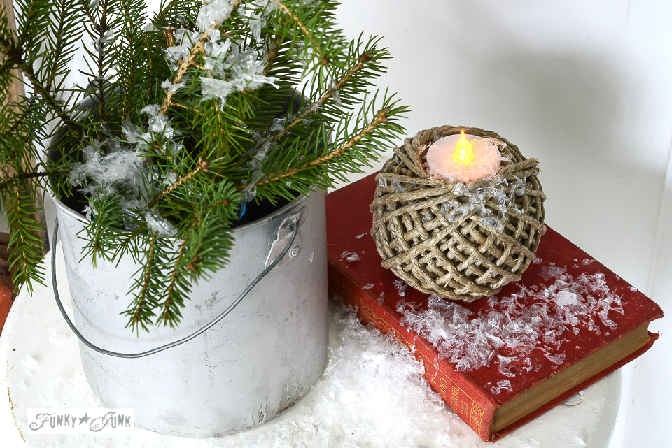 Ball of twine used as a rustic candle votive with faux snow for Christmas / funkyjunkinteriors.net