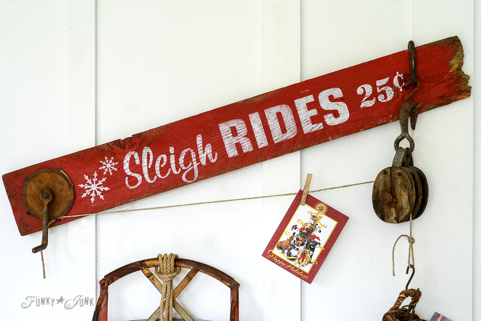 Sleigh Rides, a rustic sign for Christmas holding up Christmas cards on a pulley from Funky Junk's Old Sign Stencils / funkyjunkinteriors.net