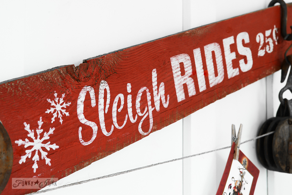 White snowflakes on a red Sleigh Rides sign for Christmas from Funky Junk's Old Sign Stencils / funkyjunkinteriors.net