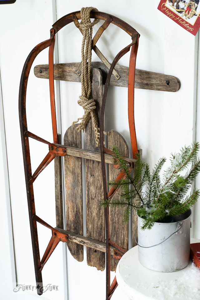 Vintage rustic and red snow sleigh as wall art for Christmas / funkyjunkinteriors.net