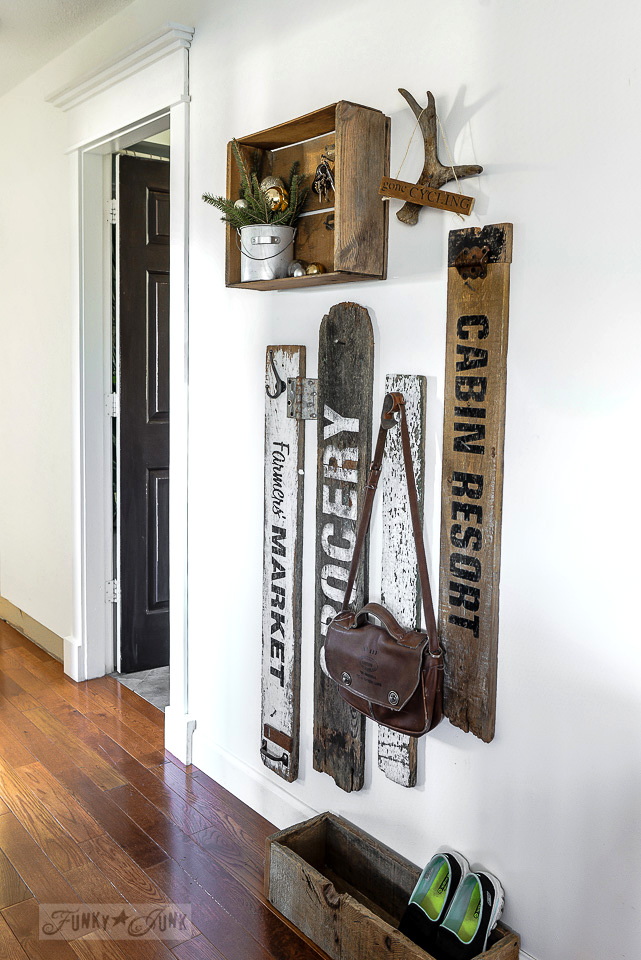 Compact old signs and crate coat hook area made with Funky Junk's Old Sign Stencils / funkyjunkinteriors.net