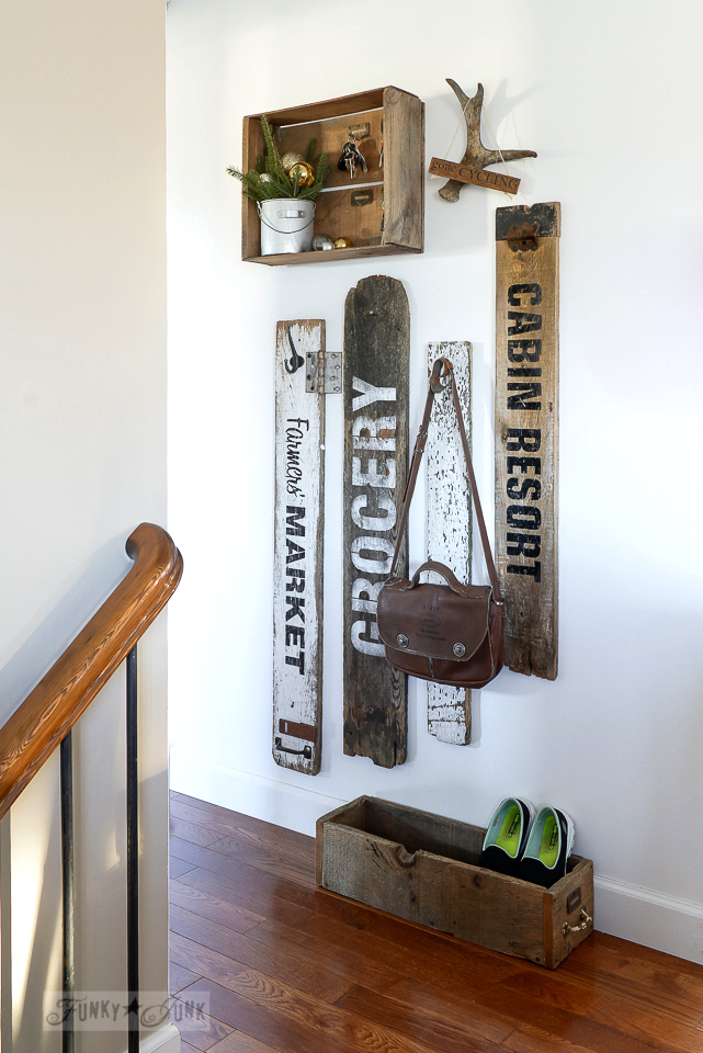 compact old sign coat hook area in a hallway using Funky Junk's Old Sign Stencils / funkyjunkinteriors.net