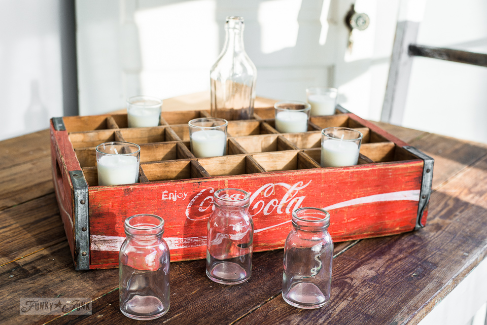 adding candles to a vintage coke crate for a Christmas candle centrepiece / funkyjunkinteriors.net