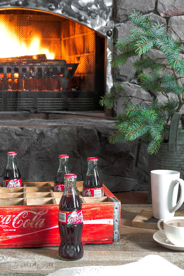 Christmas Coca Cola and vintage Coca cola crate by a roaring fireplace / part of a Christmas mantel on funkyjunkinteriors.net