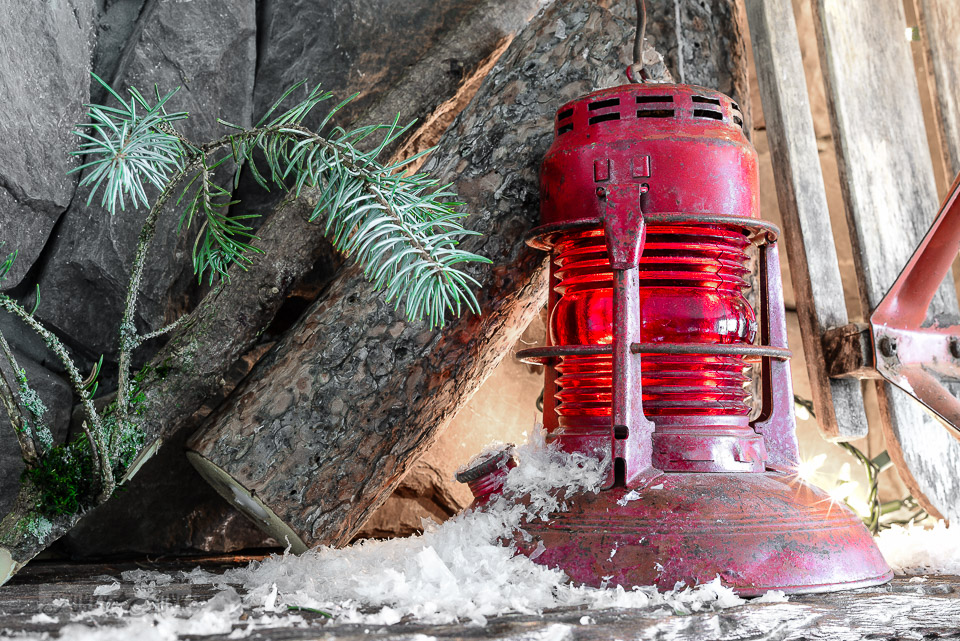 vintage red train lantern on a snowy Christmas mantel / funkyjunkinteriors.net