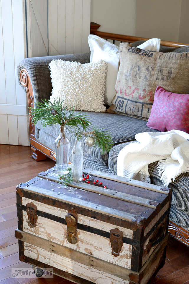 small trunk coffee table with soda bottles and evergreen branches / funkyjunkinteriors.net
