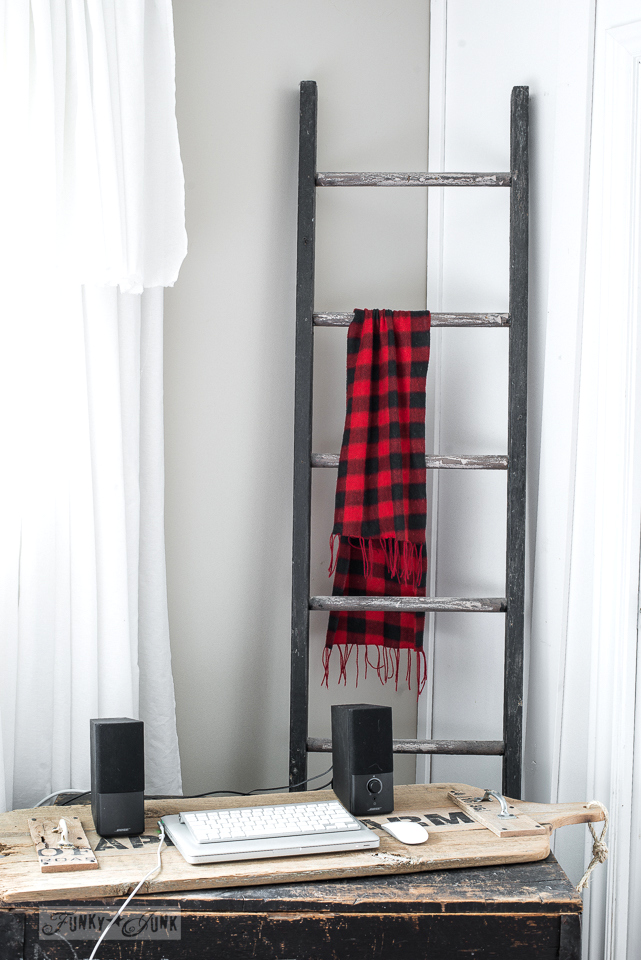 Christmas decorating with a buffalo check scarf on a rustic black ladder with laptop on a rustic bed tray / www.funkyjunkinteriors.net