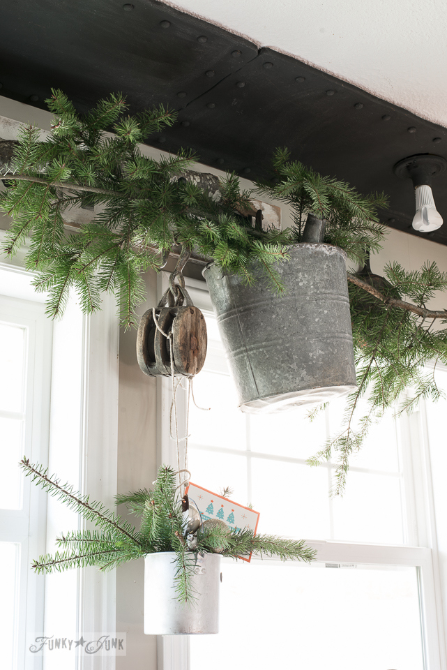 Evergreen branch kitchen valance for Christmas decorating with antique pulley / funkyjunkinteriors.net