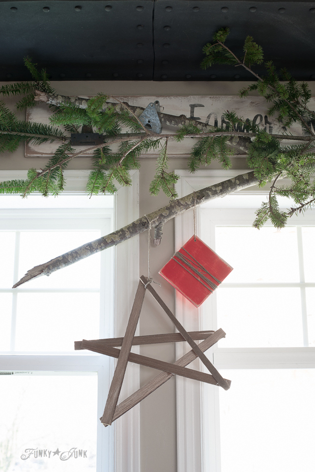 Evergreen branch valance for kitchen Christmas decorating with a twig star and wooden present / funkyjunkinteriors.net