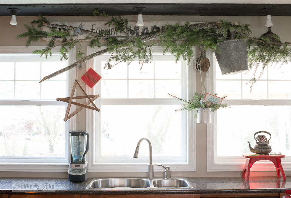 Evergreen branch valance for kitchen Christmas decorating with an antique pulley / funkyjunkinteriors.net