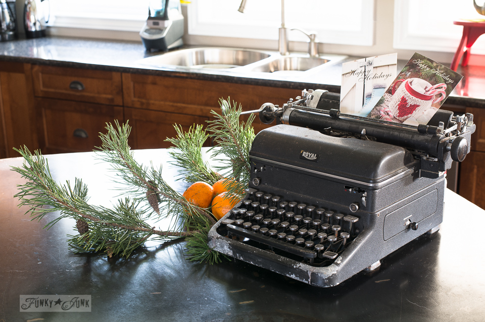 Antique black typewritter with Christmas cards as a Chrismtas centrepiece on a kitchen island / funkyjunkinteriors.net