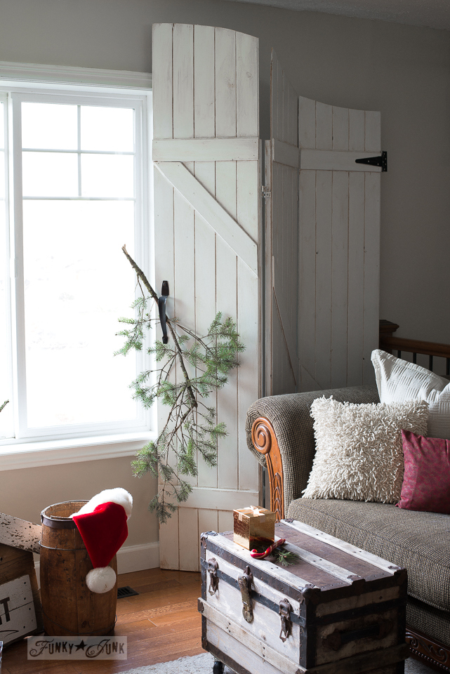 White old gate window screens with evergreen branch for Christmas decorating / www.funkyjunkinteriors.net