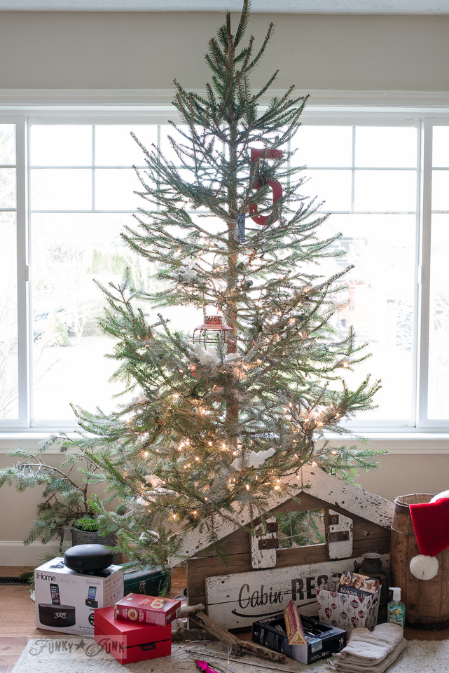 Simple real Christmas tree with opened presents underneath / www.funkyjunkinteriors.net