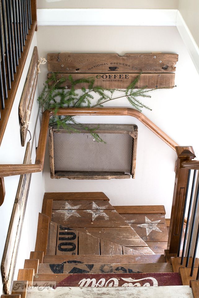 Old signs and rustic old crate stairway with evergreen branch for Christmas decorating / www.funkyjunkinteriors.net