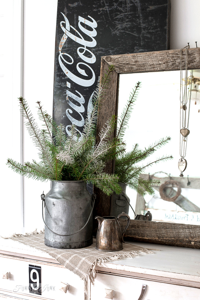 Christmas decorating with a galvanized bucket with evergreen branches with a black metal Coca Cola sign / www.funkyjunkinteriors.net