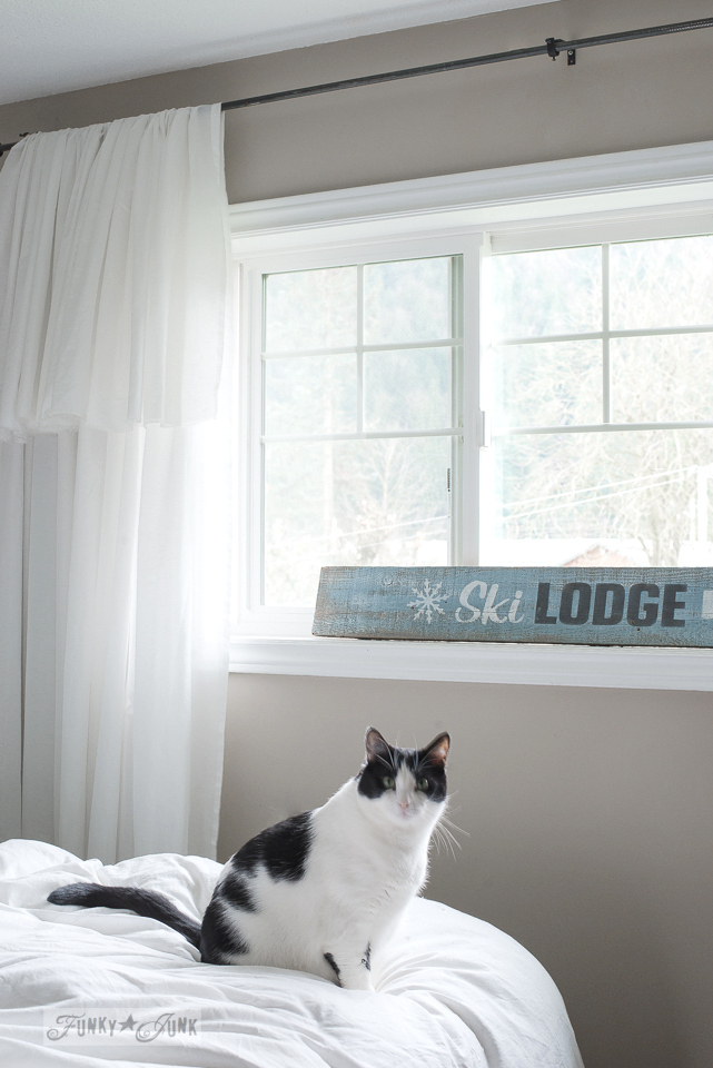 Christmas or winter decorating with a Ski Lodge blue sign in a window sill in a master bedroom / www.funkyjunkinteriors.net