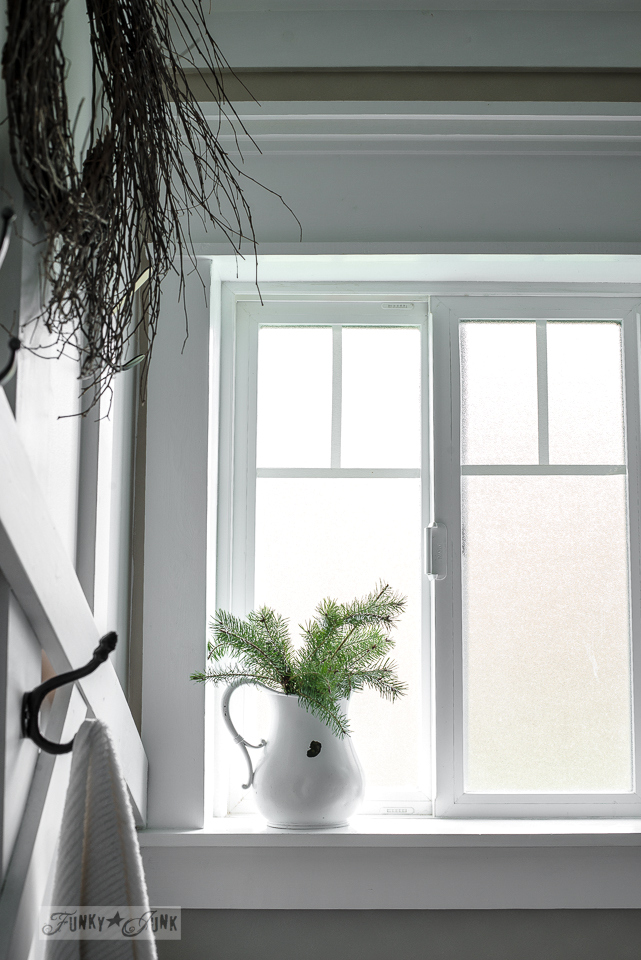 Farmhouse window with chippy white pitcher with evergreen branches for Christmas decorating / www.funkyjunkinteriors.net