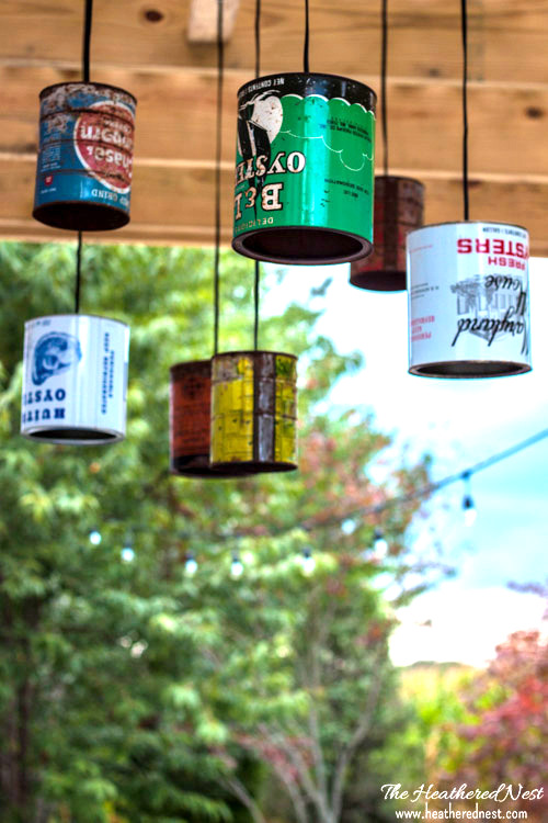 DIY Tin Can Outdoor Lighting by The Heathered Nest, featured on Funky Junk Interiors