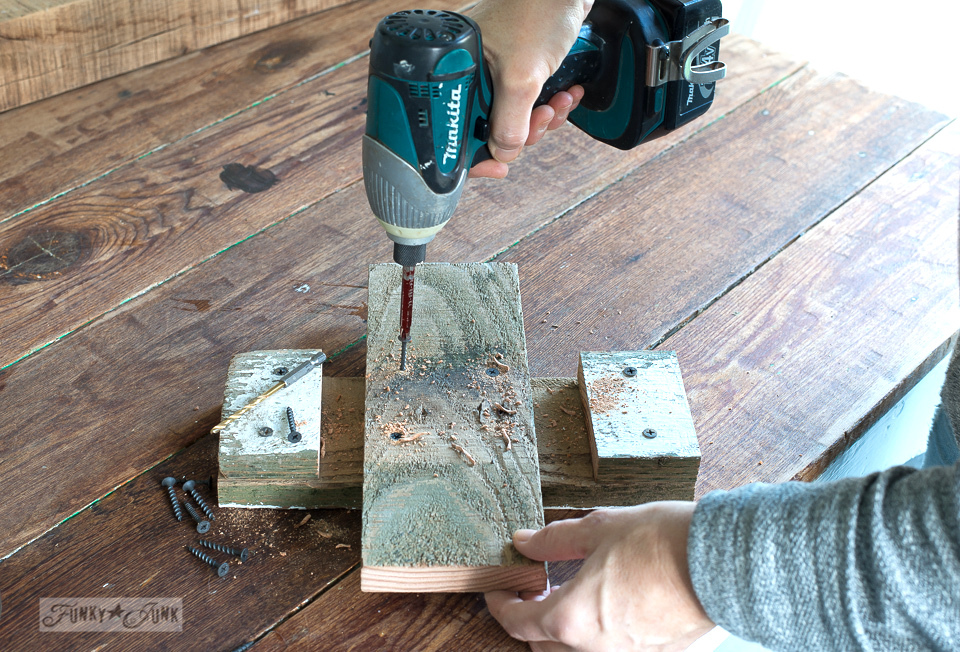 creating a tree stand from scrap wood for a DIY reclaimed wood Christmas tree