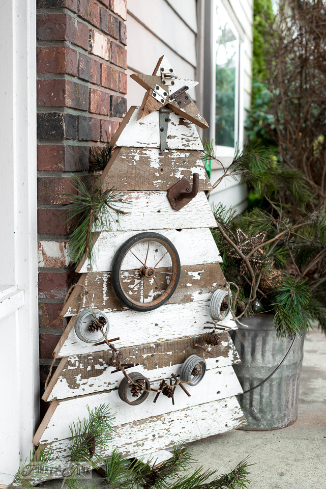 Reclaimed wood Christmas tree for the front porch with rusty junk decorations / funkyjunkinteriors.net/