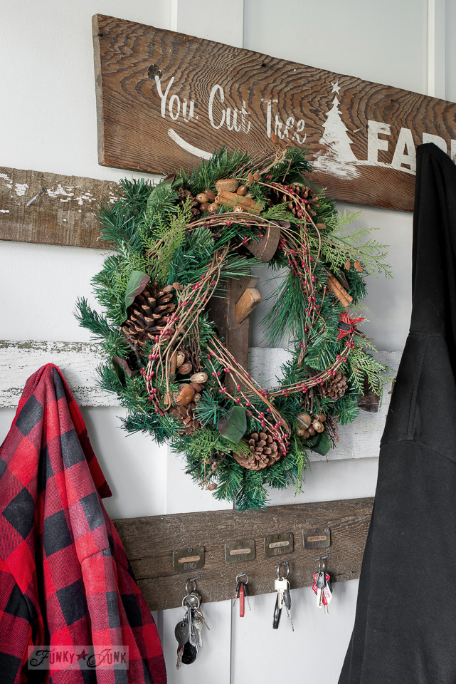 Old signs front entry and key storage with a rustic Christmas wreath / funkyjunkinteriors.net