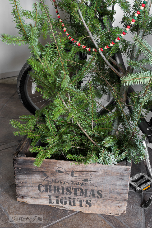 Christmas tree in a crate with Merry & Bright Christmas Lights stencil / funkyjunkinteriors.net